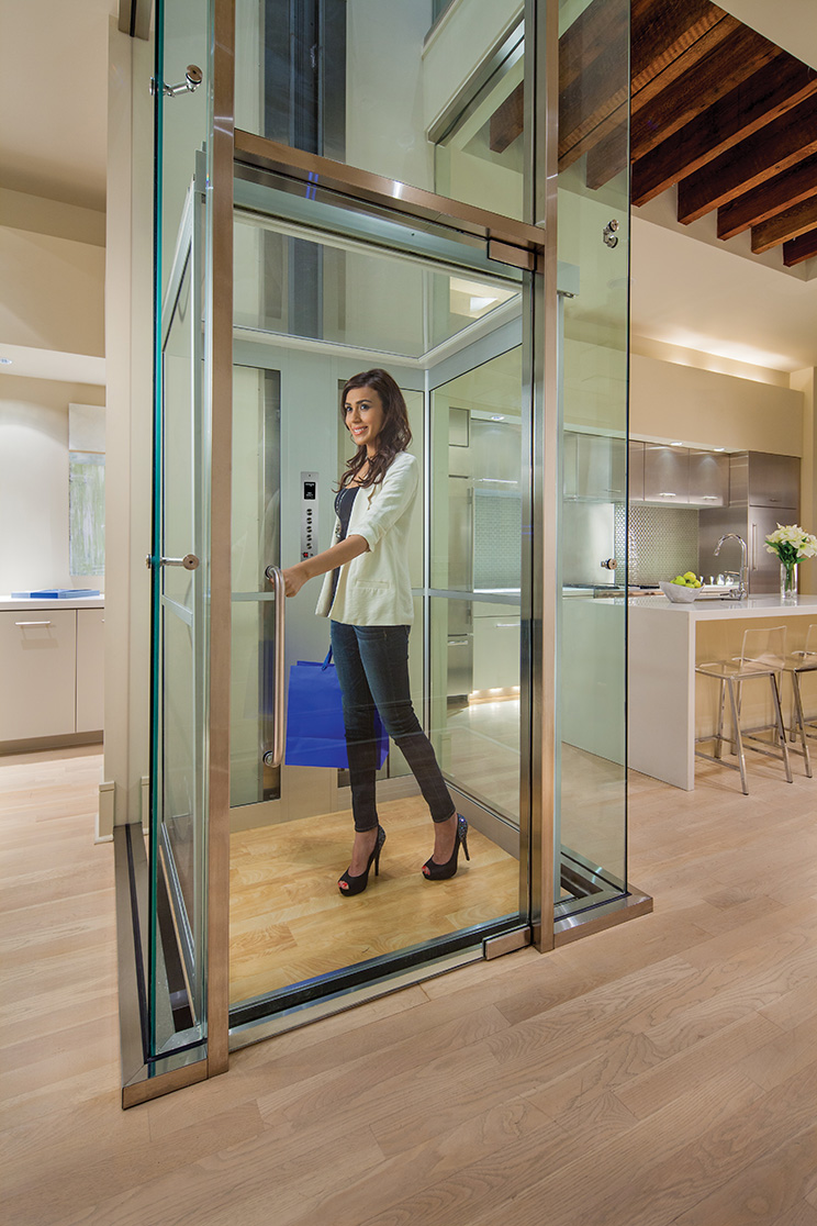 woman in home elevator surrounded by glass